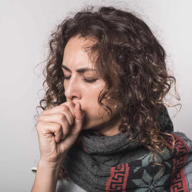 sick-woman-coughing-against-gray-background_23-2147889434